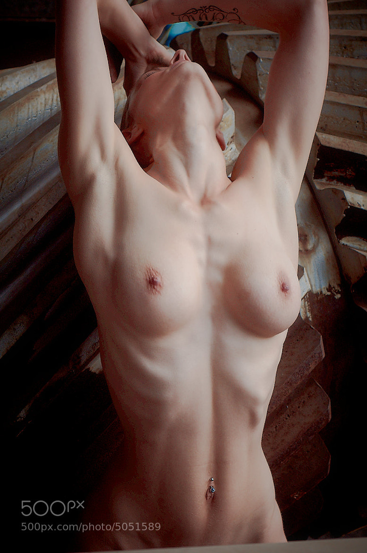 Naked girl in factory