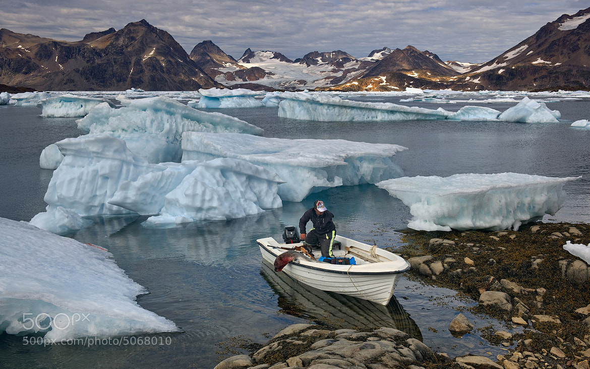 Photograph One-armed Inuit man coming back after seal hunt by Mike Reyfman on 500px