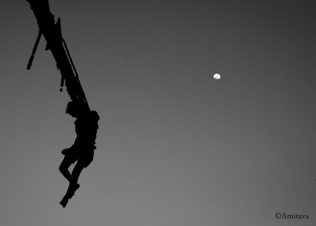 Photograph Moon & The Suspended Man by Amitava Das on 500px