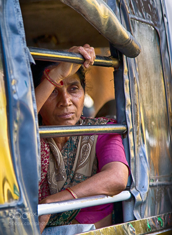 Digital color image of woman with a sad face on a bus in Indore, India