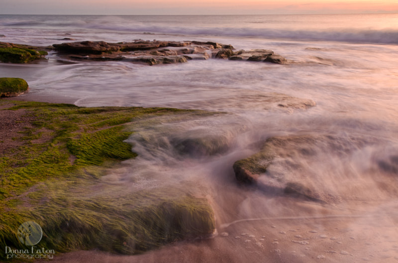 Slow exposure of surf over the Coquina rocks at Fort Fisher, NC.