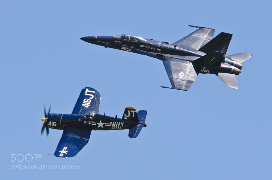 Past and present meet as the F4U Corsair (bottom) and F-18C Hornet (top) join up for the US NAVY Legacy Flight. MCAS Beaufort 2011