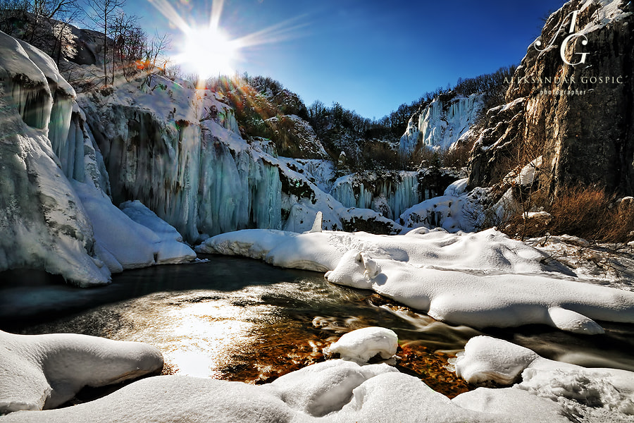 Quiet winter day in Plitvice lakes NP, below frozen Sastavci falls, Korana river is making its first steps