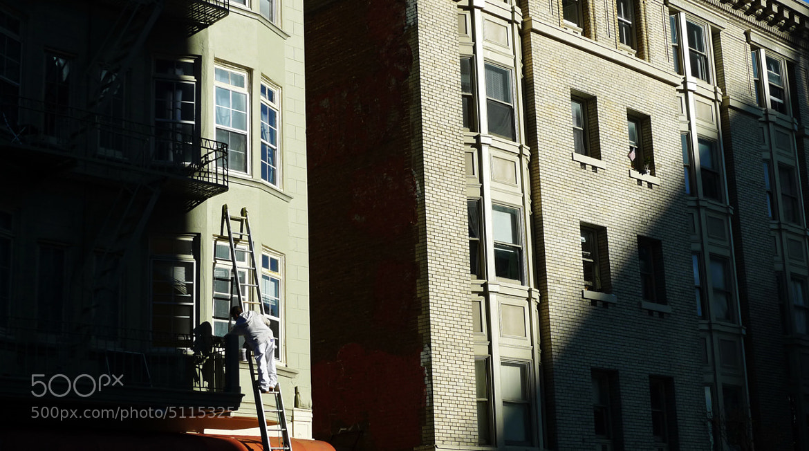 Photograph Man on Ladder in the Tenderloin by The Tens on 500px