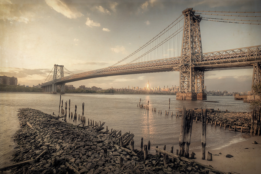 The Williamsburg Bridge in Net York City during Golden Hour, processed with a vintage feel.