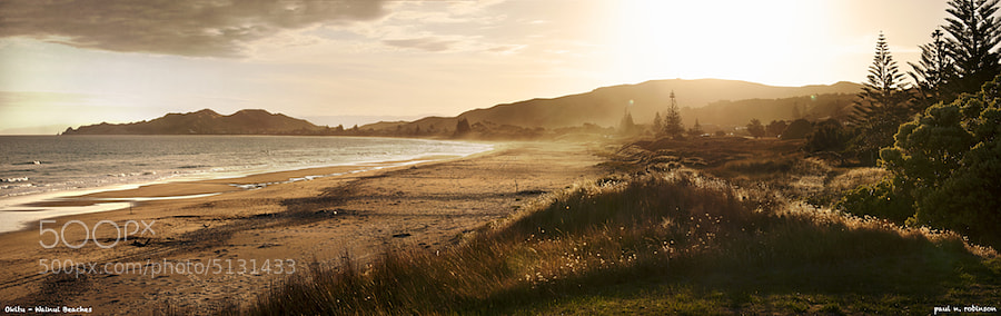 New Zealand coastline north of Gisborne. Okitu and Wainui beaches at sundown. 