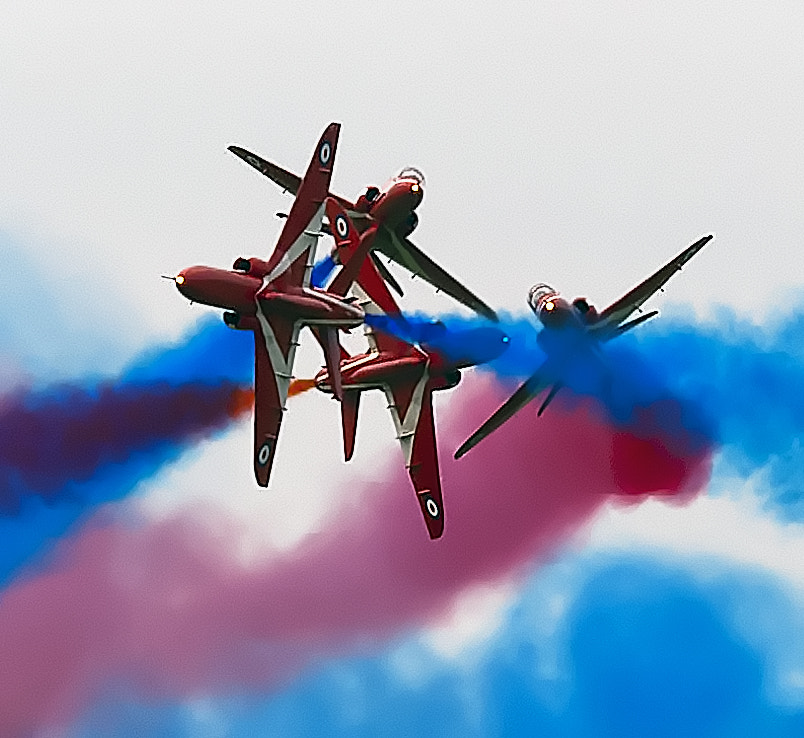 The RAF Red Arrows do a four plane cross