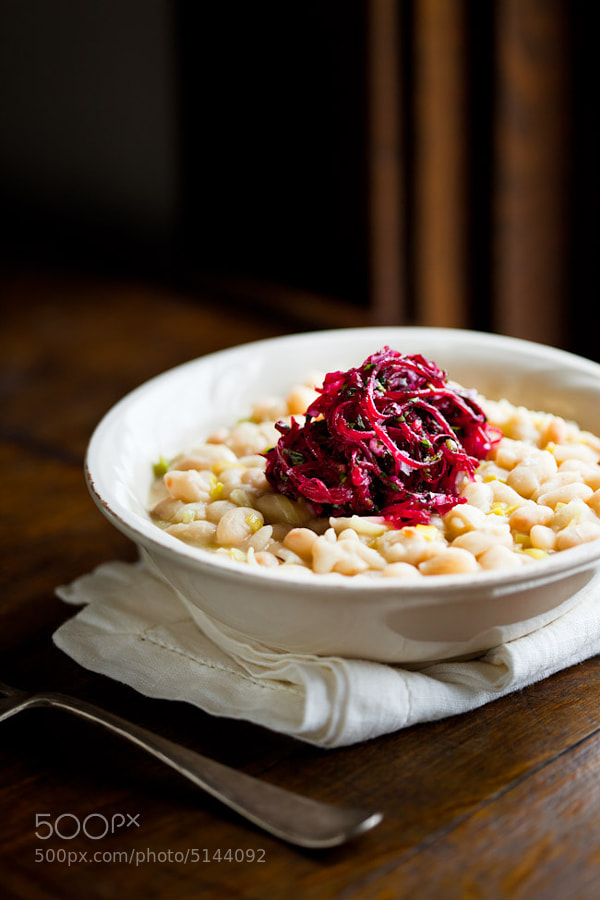 beans cooked with leeks, garlic, white wine and butter. a simple salad of raw beet, garlic confit, many herbs.