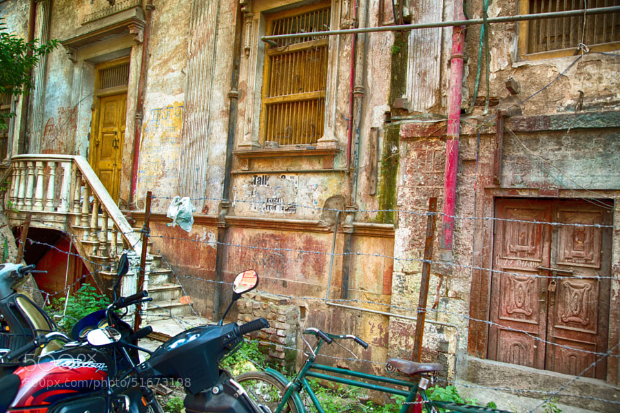 Digital HDR color image of a run-down building on a side street near the cloth market in Indore, India