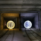 Light orbs in an underground railway.