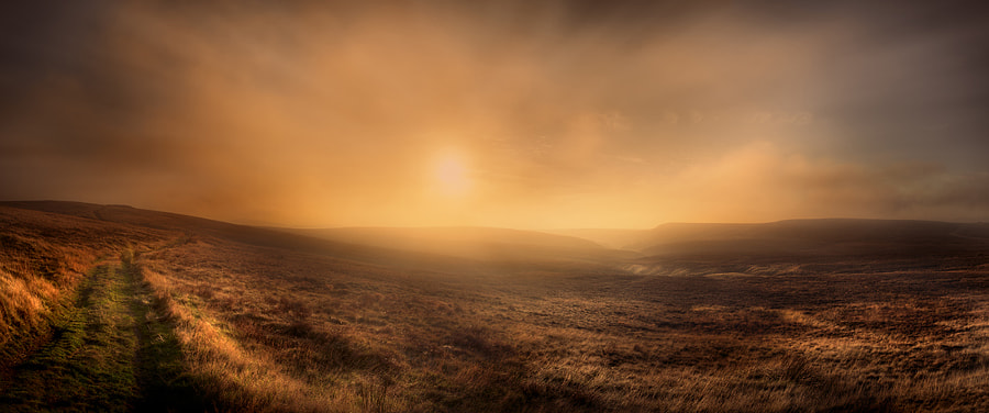 Late afternoon sunlight on Axe Edge in the Peak District