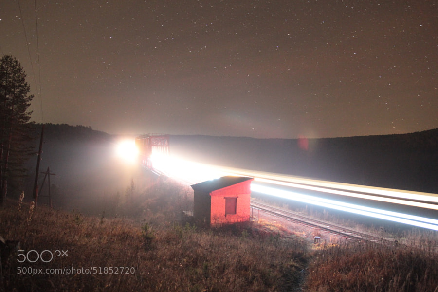 Train on the bridge under stars by Maxim Tashkinov on 500px.com