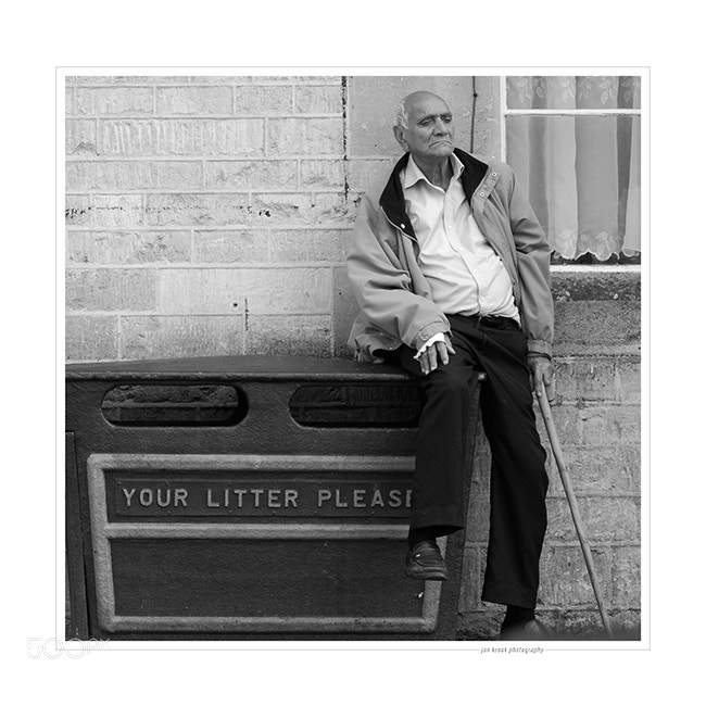 Man waiting for the bus in Swindon (UK). The expression on his face in combination with the text on the garbage can made it a very current image in the context of retirement reform in most EU member states.