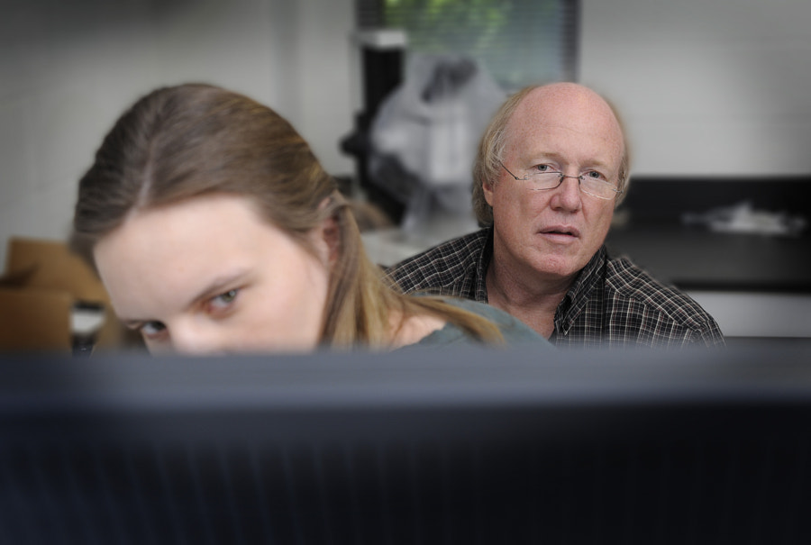 Dr. David Threadgill works with a student on main