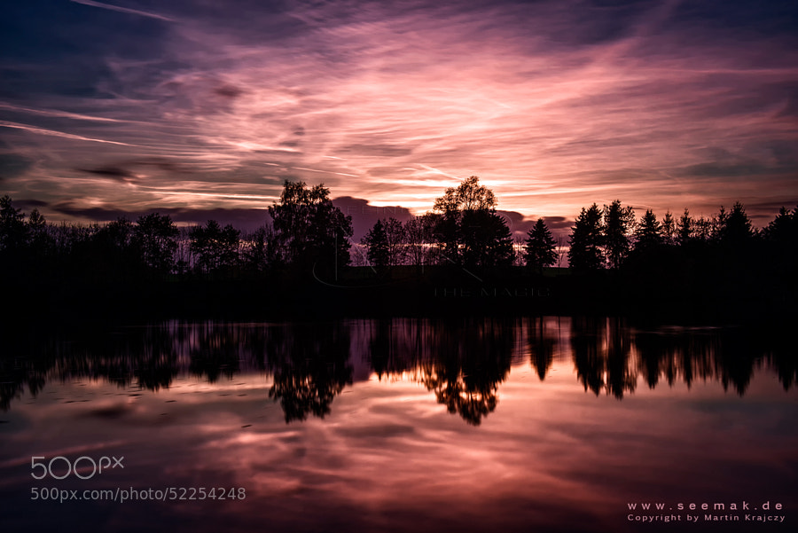 Autumn sunset in northern Germany at a small fishing lake.