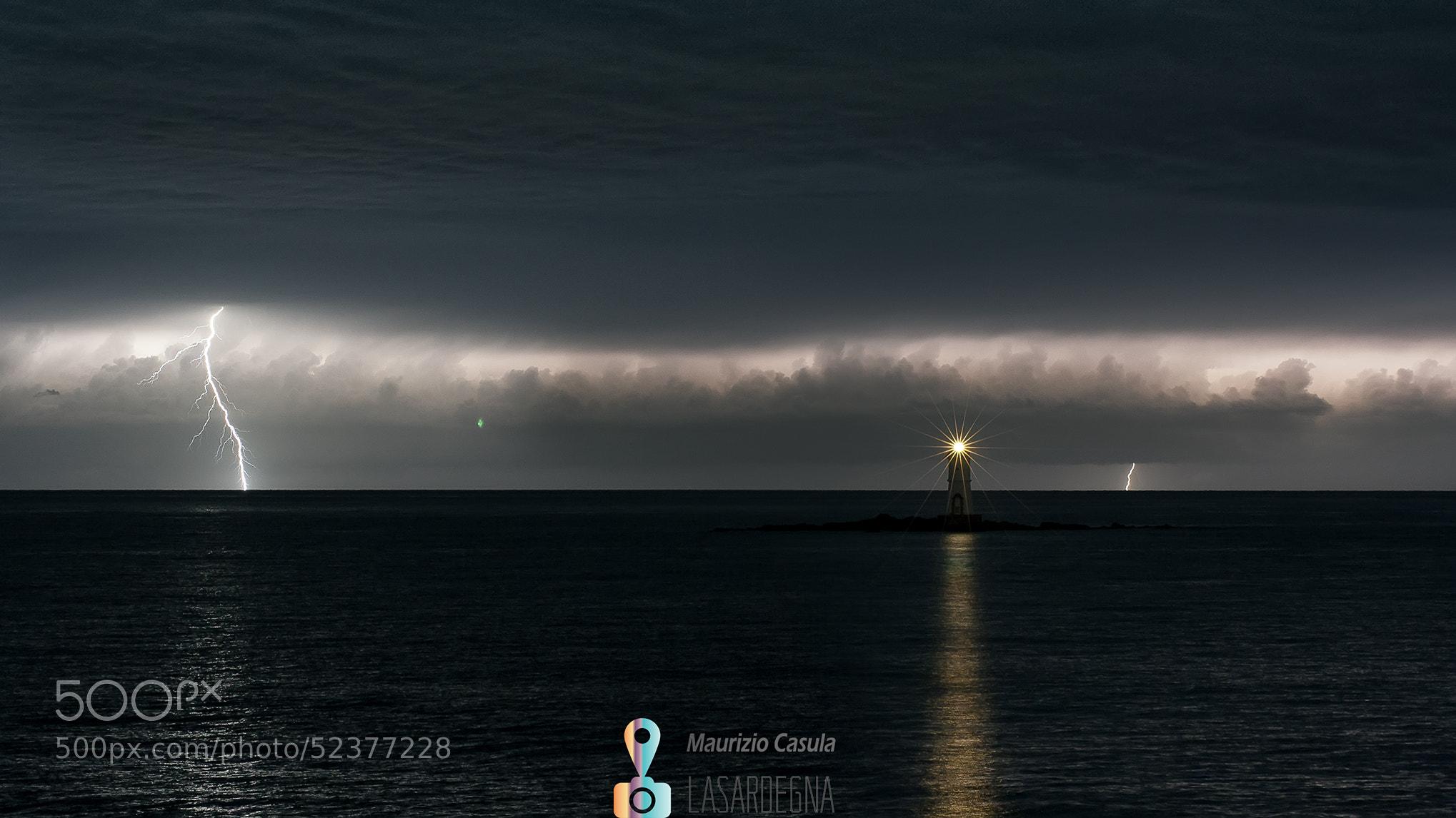 Photograph lighthouse mangiabarche & lightning by Maurizio Casula on 500px