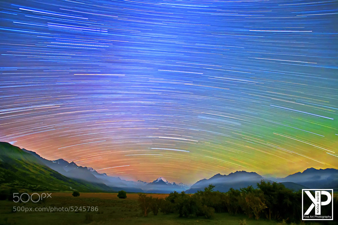 Photograph Colorful Startrails over Mr. Cook by Keith Poon on 500px