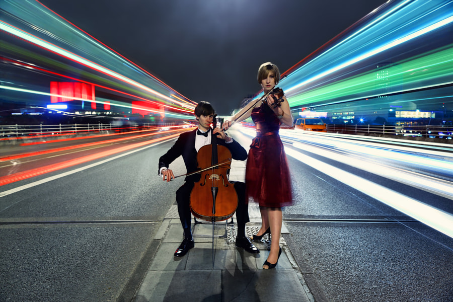 Violinist & Cellist Performing in Traffic by Anatoleya  on 500px.com