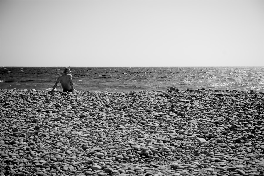 Photograph Man at the beach. by Erik Olsson on 500px