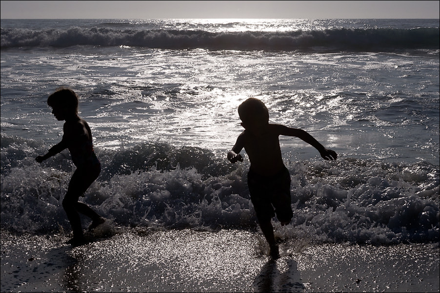 Photograph My kids playing in surf by Alex S. on 500px