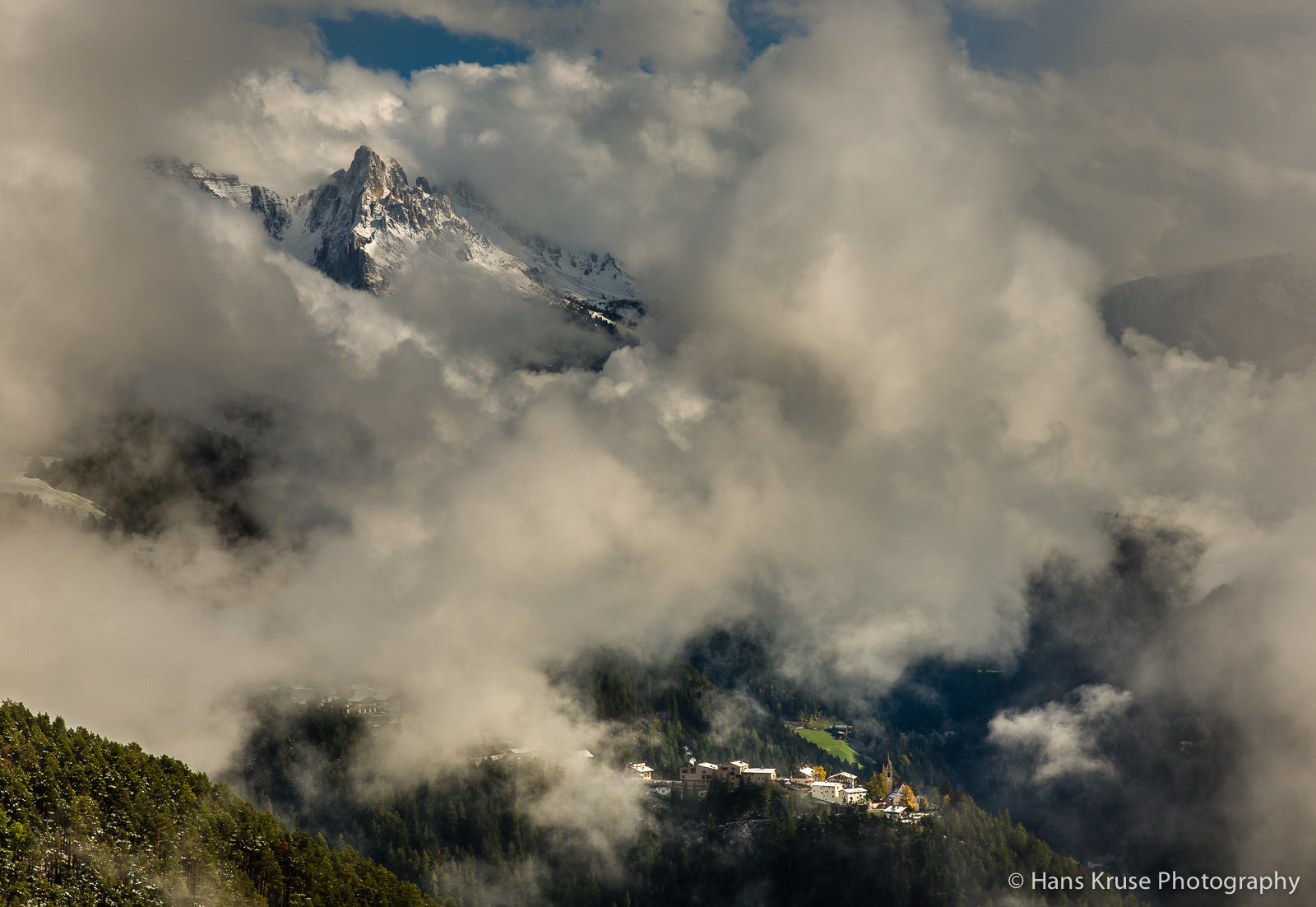 Photograph San Valentino in Campo, Latemar and clouds by Hans Kruse on 500px