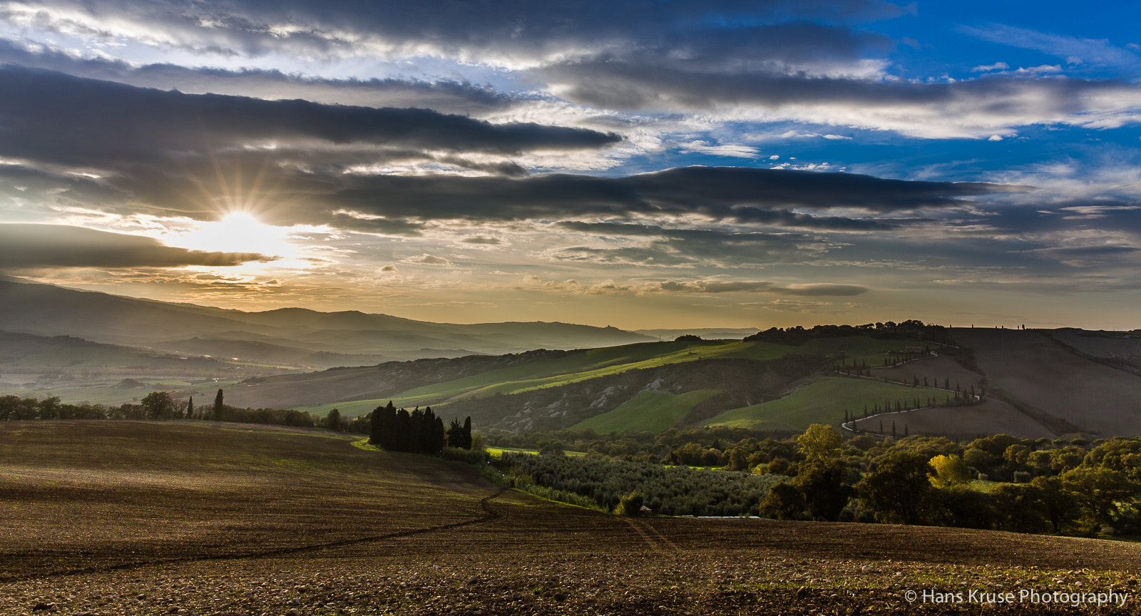Photograph Tuscany with winding road at late afternoon by Hans Kruse on 500px