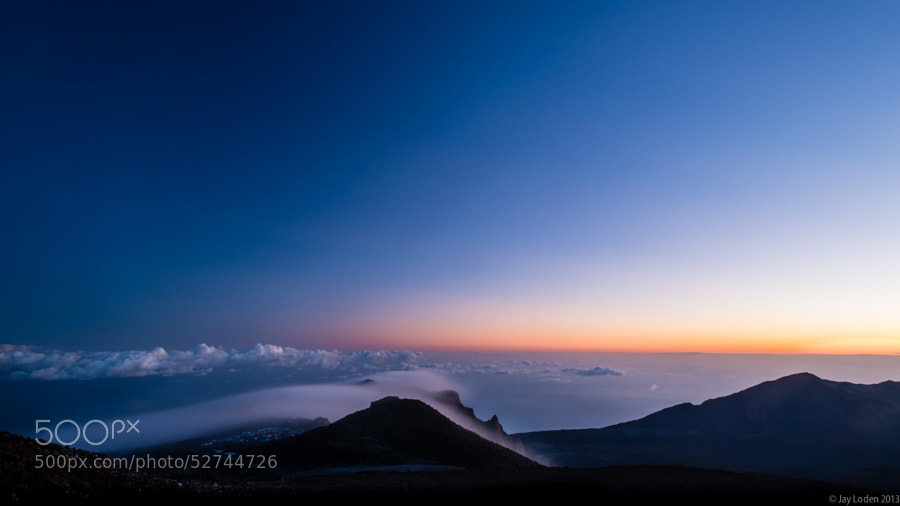 Visiting Haleakala National Park, Maui to see the stars and watch the sun rise over the crater.  A truly memorable experience, and an incredibly beautiful sight!