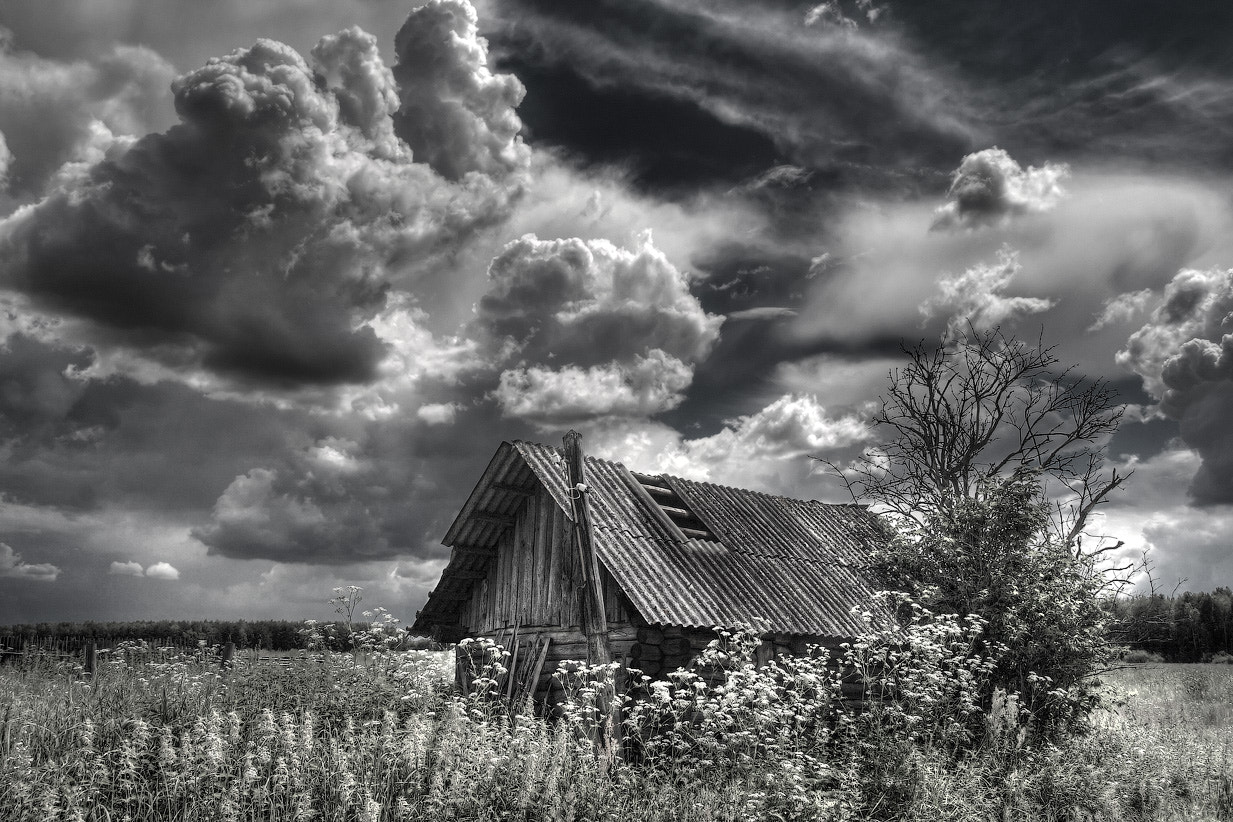Photograph Dramatic sky and old house by Alexander Asedach on 500px