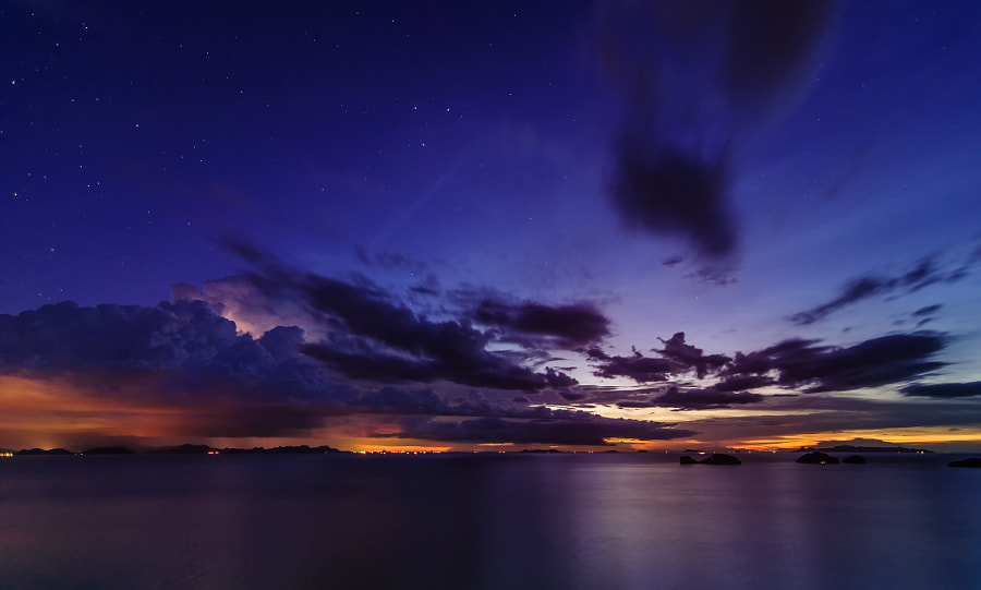 Lightning in the clouds at twilight over Koh Samui, Thailand