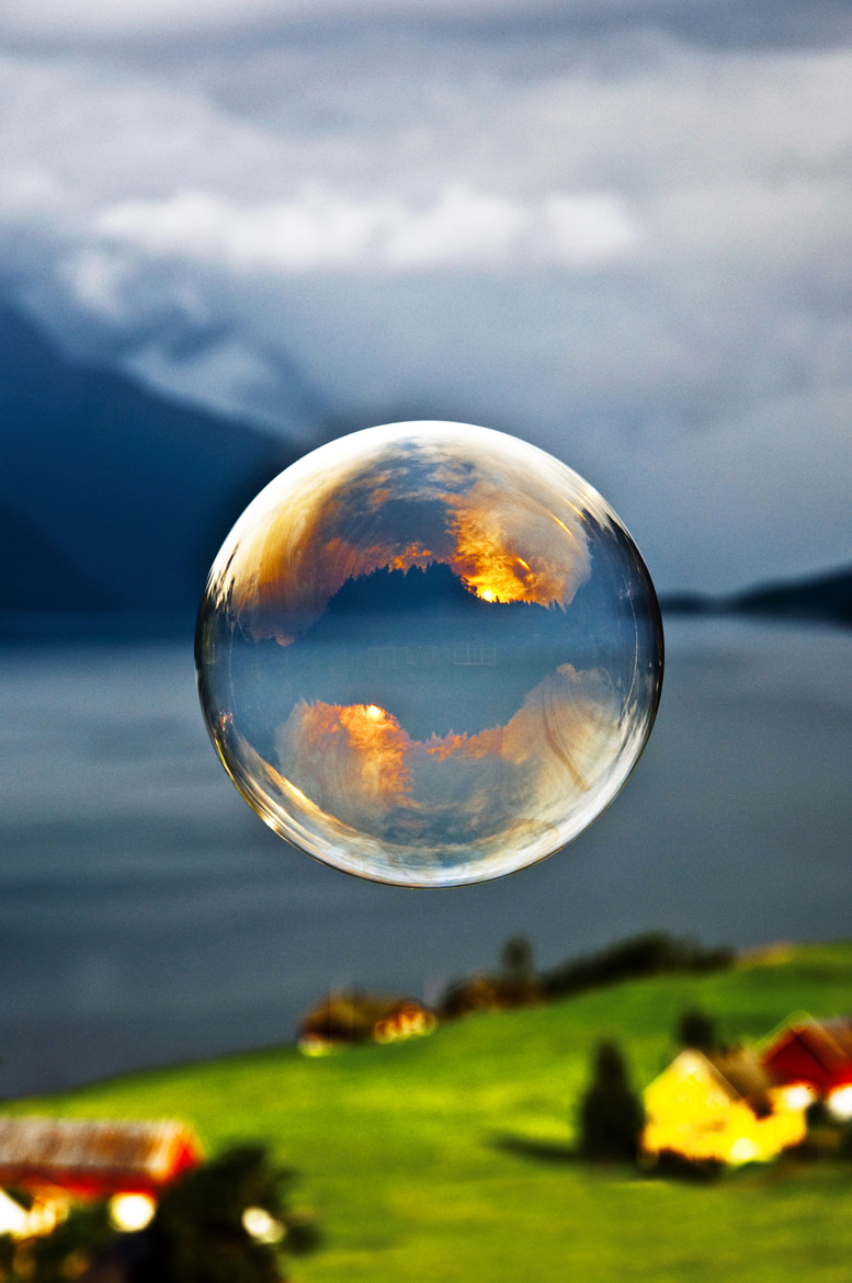 Photograph Morning light reflected in a soap bubble over the fjord by Odin Hole Standal on 500px