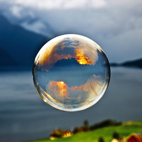 Morning light reflected in a soap bubble over the fjord by Odin Hole Standal (Odinodin)) on 500px.com
