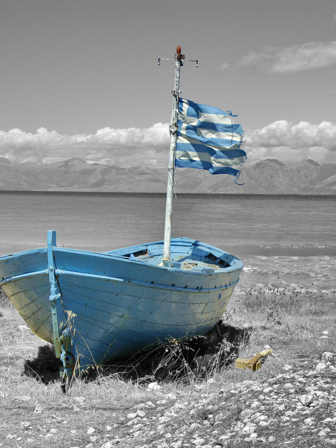 The blue boat on the beach, Albania, in the background