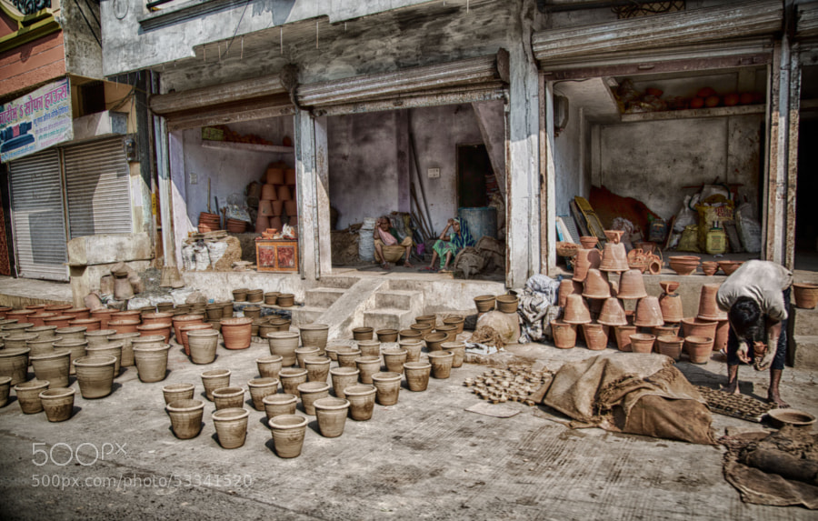 Digital color HDR image of flower pots for sale on a street corner in Indore, India