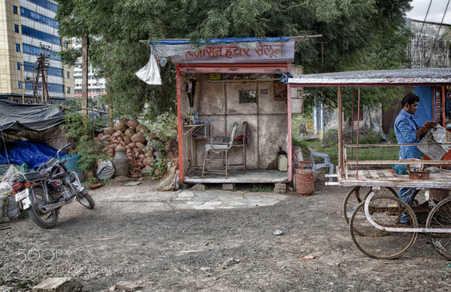 Digital color HDR image of barber shack on a roadside in Indore, India