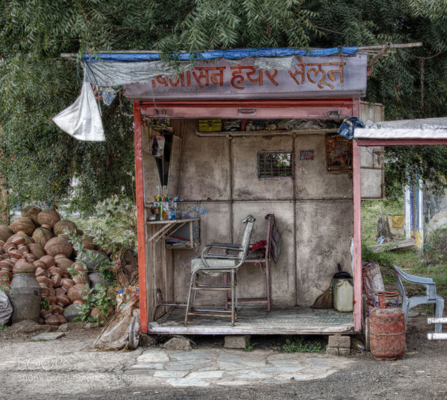 Digital color HDR image (zoomed) of barber shack on a roadside in Indore, India