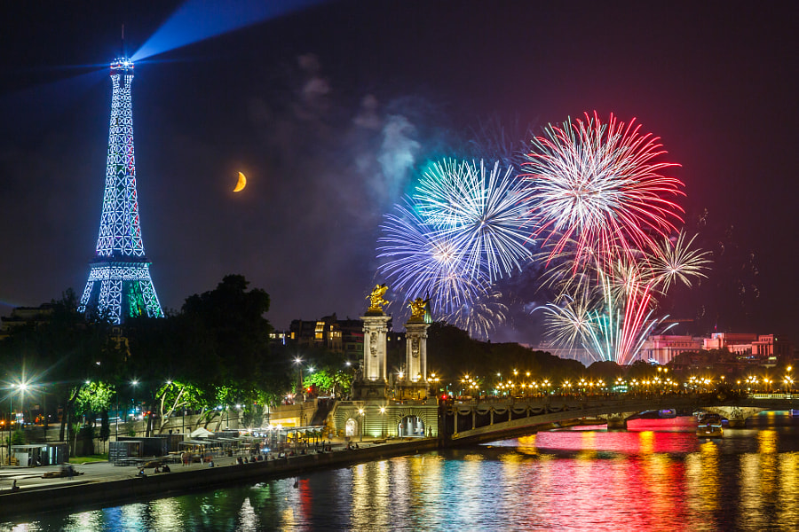 Fireworks in Paris with Eiffel Tower and the Moon