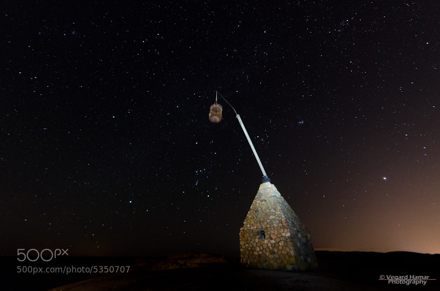 The Tipping Lantern (Bascule Light) at Worlds End (Verdens Ende) in Norway, taken last night. Tipping lantern is light-painted with my headlamp.