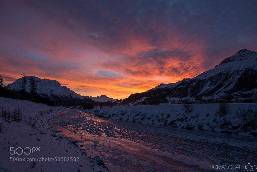 Frozen river sunset