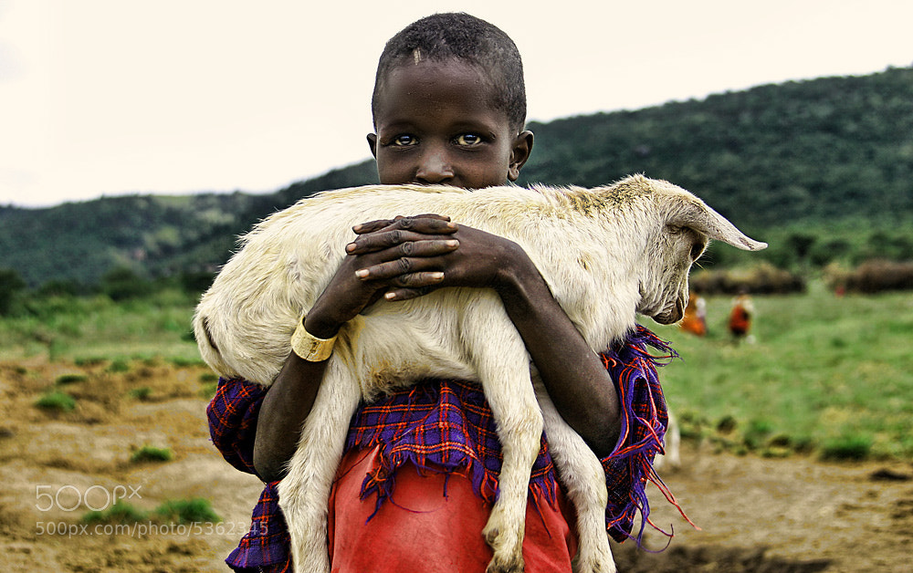 Photograph Boy and a goat by Dmitri  Markine on 500px