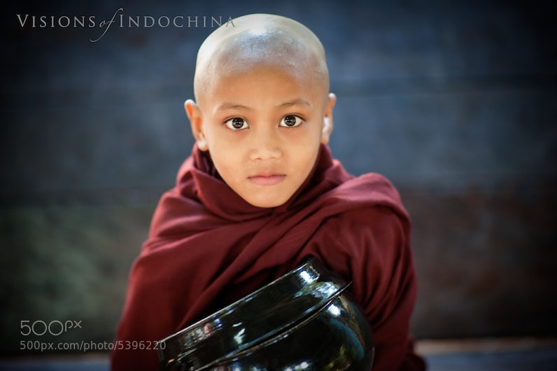 Photograph A Burmese novice monk awaiting alms at a Yangon monastary by Visions of Indochina on 500px