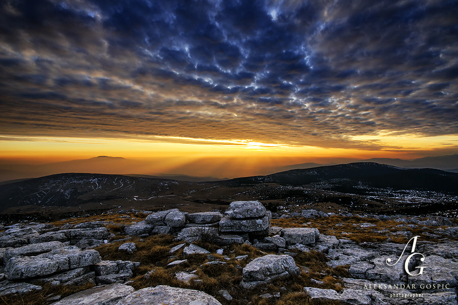 View from mountain Dinara reveals the Adriatic haze that crawled deep into the mainland of northern Dalmatia, while altocumulus in the sky announce worsening of the weather and arrival of the cold front in a few hours