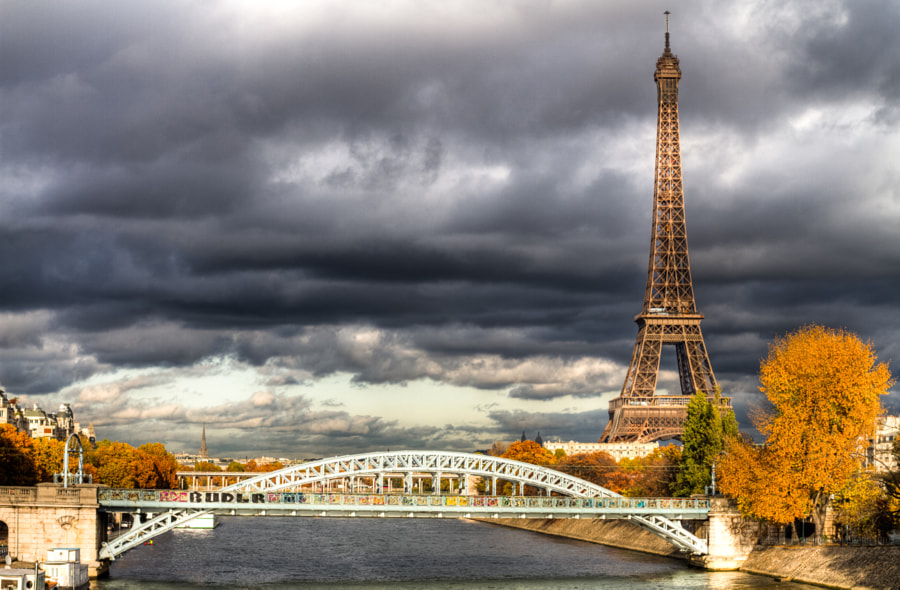 Eiffel Tower under a menacing sky from Grenelle bridge in fall