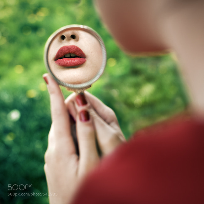 Reflection of pouting on a  mirror