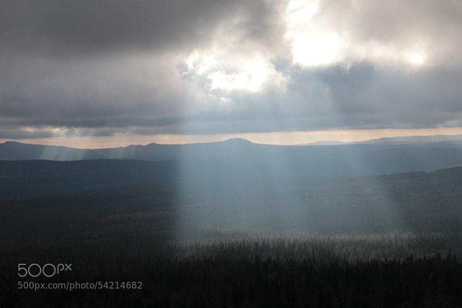 rays through the clouds by Maxim Tashkinov on 500px.com