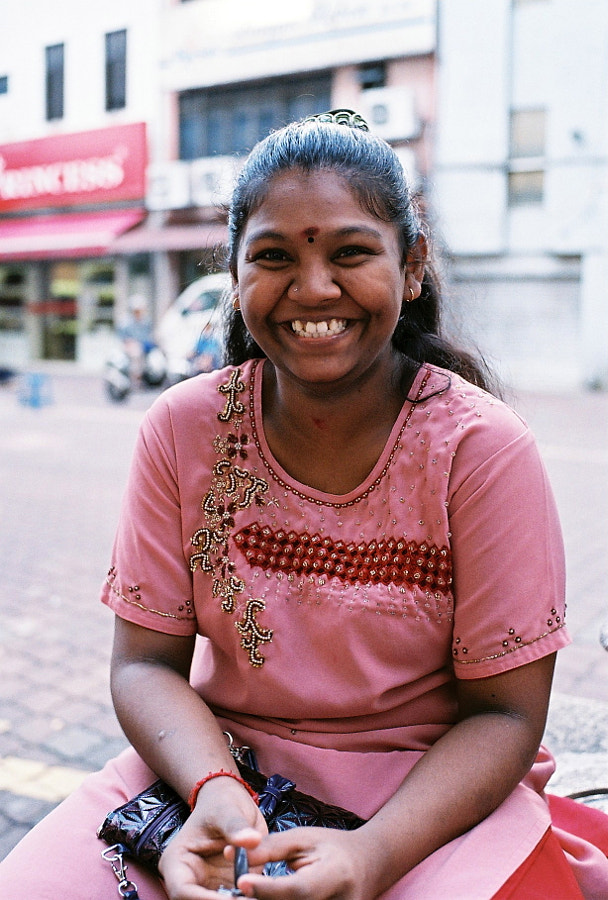 I met her on the street. She was sitting there with her friend. A friendly girl with great smile. At Kuala Lumpur, Malaysia.