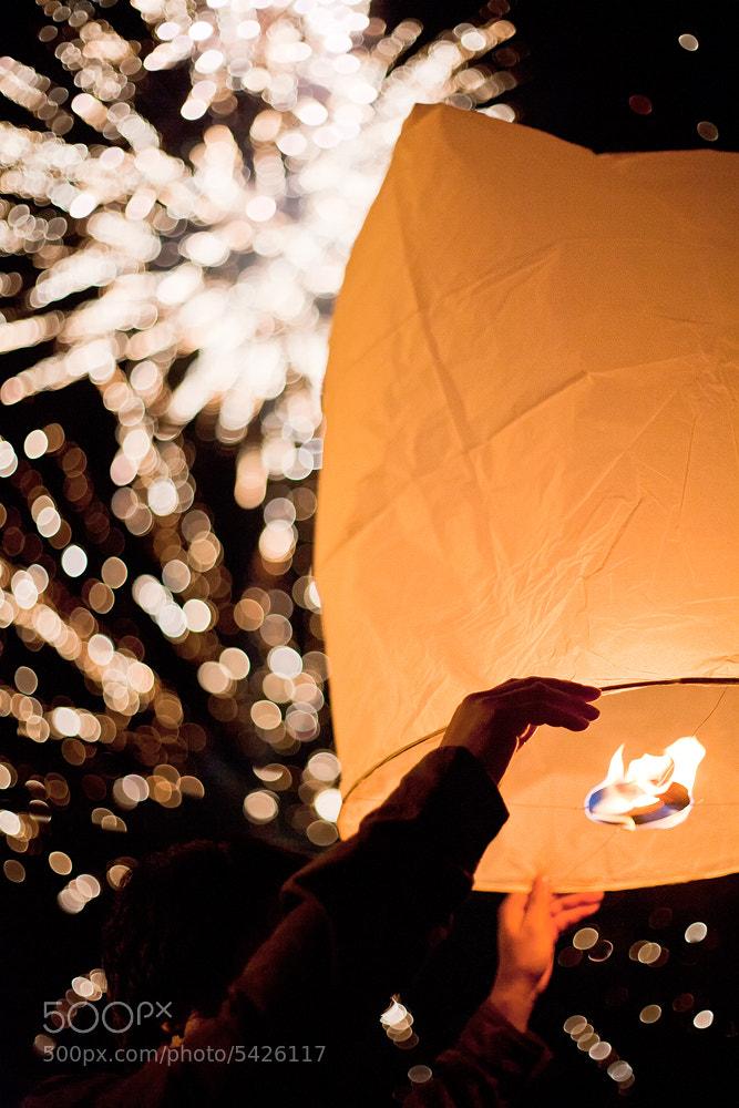 Photograph Sky Lantern Fireworks by Jon Reid on 500px
