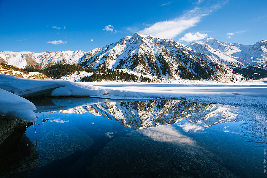 "Big a href=""/place/8909/almaty""span itemprop=""location""Almaty/span/a lake on december. Water, ice, mountains and snow. de Roman Barelko en 500px.com"