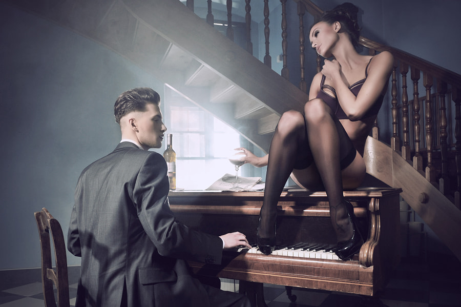 Sexy couple in an intimate situation with piano by artur k on 500px.com