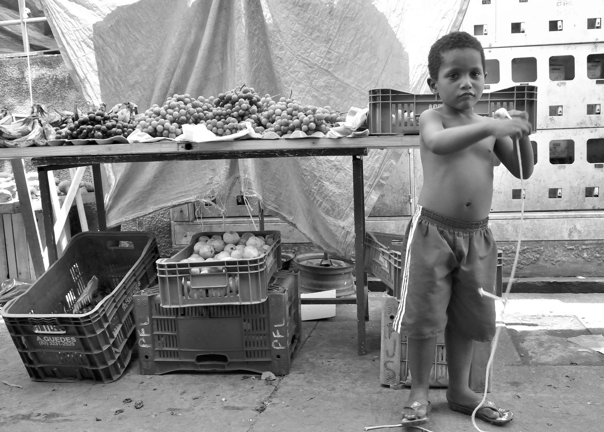 Photograph kid at the market by Helvio Silva on 500px