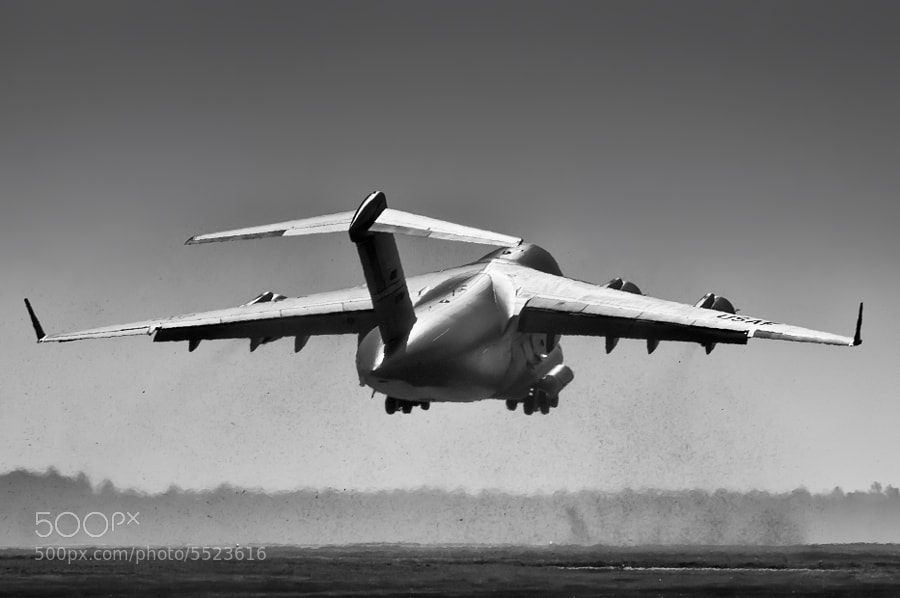 A C-17 taking off leaves a large cloud of heat and dust in its wake. Moody AFB, Nov 2010.